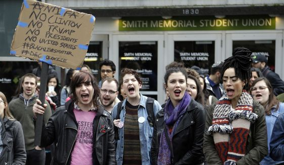 Protesters chant before marching through the streets in Portland, Ore., Wednesday, Nov. 16, 2016. Approximately 100 students at Portland State University joined a nationwide campus walkout to protest President-elect Donald Trump. (AP Photo/Don Ryan)
