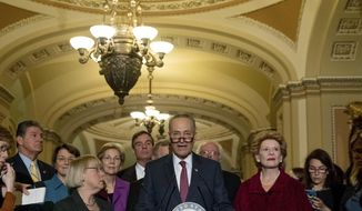 Sen. Chuck Schumer, D-N.Y., center, accompanied by the Senate Democrats, speaks to reporters on Capitol Hill in Washington, Wednesday, Nov. 16, 2016, after being chosen Senate Minority Leader for the 115th Congress. From left are, Sen. Joe Manchin, D-W.Va., Sen. Amy Klobuchar, D-Minn., Sen. Patty Murray, D-Wash., Sen. Elizabeth Warren, D-Mass., Sen, Mark Warner, D-Va., Senate Minority Whip Richard Durbin of Ill., Schumer, Sen. Bernie Sanders, I-Vt., and Sen. Debbie Stabenow, D-Mich.  (AP Photo/Andrew Harnik)