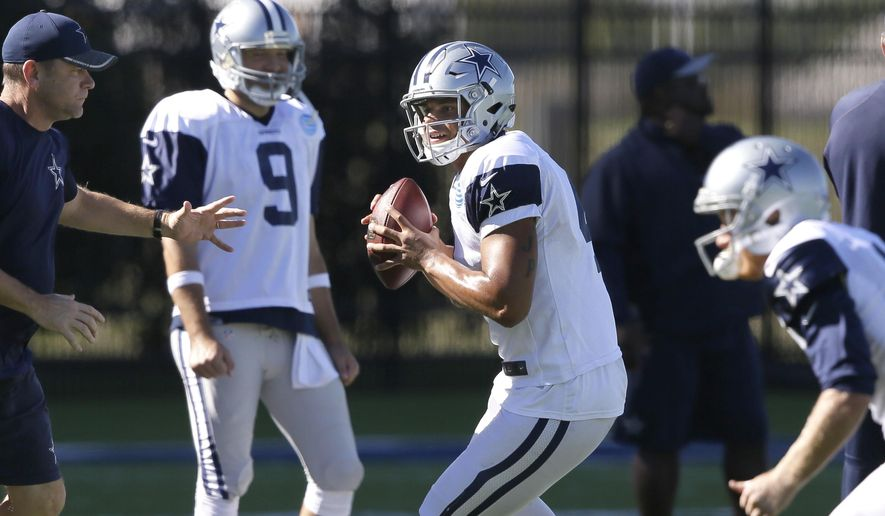 Dallas Cowboys starting quarterback Dak Prescott (4) looks to pass as backup quarterback Tony Romo looks on during an NFL football team practice in Frisco, Texas, Wednesday, Nov. 16, 2016. Prescott frequently said the Dallas Cowboys were still Tony Romo's team even when the rookie had early success. But now the 36-year-old has declared himself the backup, leaving no doubt it's Prescott's team. (AP Photo/LM Otero)