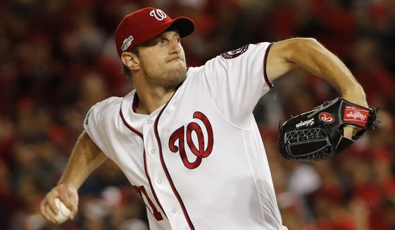 FILE - In this Oct. 13, 2016, file photo, Washington Nationals starting pitcher Max Scherzer winds up during the first inning in Game 5 of baseball's National League Division Series, against the Los Angeles Dodgers, in Washington. Scherzer, Kyle Hendricks and Jon Lester are competing for the National League Cy Young Award.  (AP Photo/Pablo Martinez Monsivais, File)