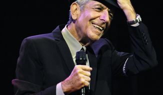 In this April 17, 2009, file photo, Leonard Cohen performs during the first day of the Coachella Valley Music & Arts Festival in Indio, Calif. (AP Photo/Chris Pizzello, File)