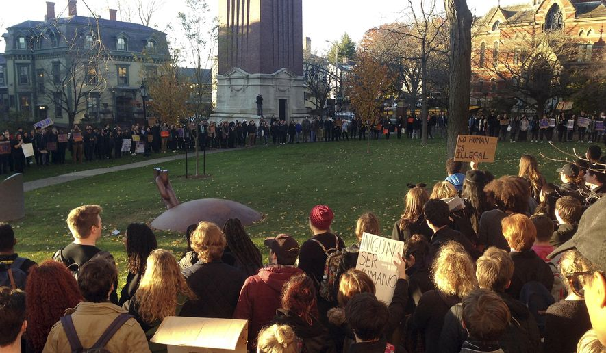 Students protest on the Brown University campus, Wednesday, Nov. 16, 2016, in Providence, R.I., to demand that students and employees be protected against immigration proceedings following the election of Donald Trump as president. Hundreds of students walked out of their classrooms and activities at 3 p.m. (AP Photo/Jennifer McDermott) **FILE**