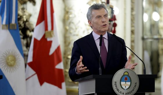 Argentine President Mauricio Macri has a complicated history with President-elect Donald Trump that stretches back into the mid-1980s. (Associated Press)