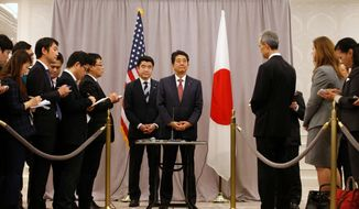 "Japanese Prime Minister Shinzo Abe (center) made a stop in New York to meet with President-elect Donald Trump while en route to an APEC meeting in Lima. He later describe the encounter as ""cordial and candid."" (Associated Press)"