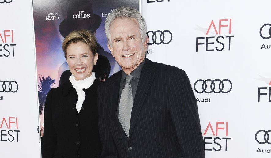 "Warren Beatty, right, and Annette Bening arrive at the world premiere of ""Rules Don't Apply"" on opening night of the 2016 AFI Fest on Thursday, Nov. 10, 2016, in Los Angeles. (Photo by Richard Shotwell/Invision/AP)"