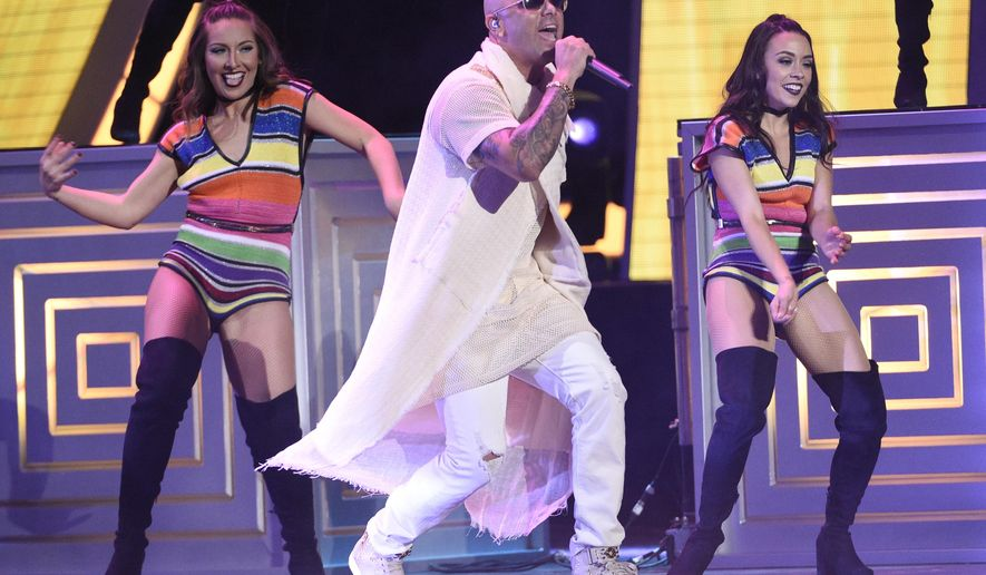 "Wisin performs ""Vacaciones"" at the 17th annual Latin Grammy Awards at the T-Mobile Arena on Thursday, Nov. 17, 2016, in Las Vegas. (Photo by Chris Pizzello/Invision/AP)"