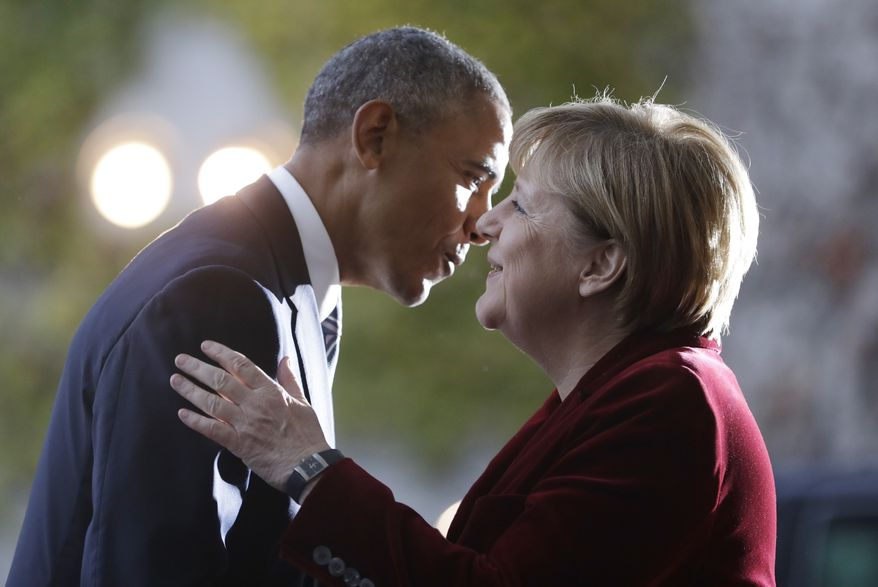 U.S. President Barack Obama, left, is welcomed by German Chancellor Angela Merkel prior to a meeting in the chancellery in Berlin, Germany, Thursday, Nov. 17, 2016. Germany is the last European stop of Obama's final tour abroad as U.S. president. (AP Photo/Michael Sohn)