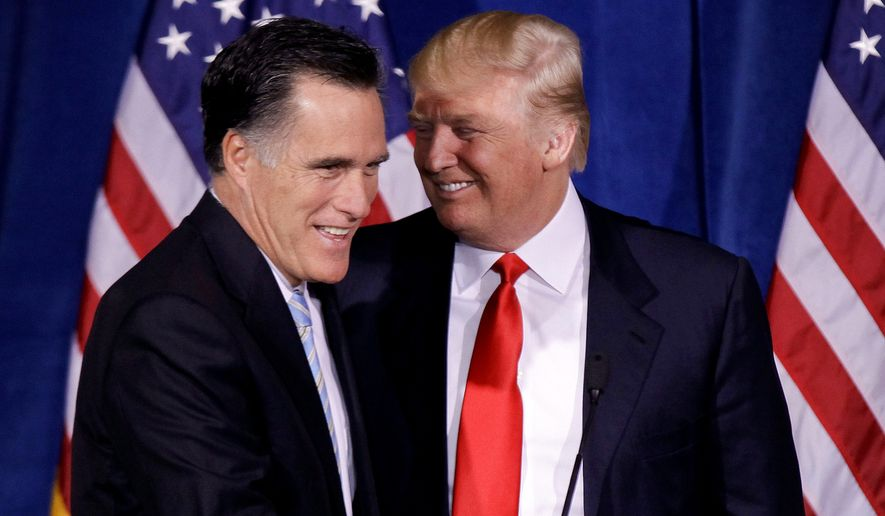 In this Feb. 2, 2012 file photo, Donald Trump greets Republican presidential candidate, former Massachusetts Gov. Mitt Romney during a news conference in Las Vegas. Mr. Romney will meet with President-elect Donald Trump on Nov. 19, 2016, as Mr. Trump continues meetings with prospective Cabinet members and works on his transition to the White House. (AP Photo/Julie Jacobson, File) **FILE**