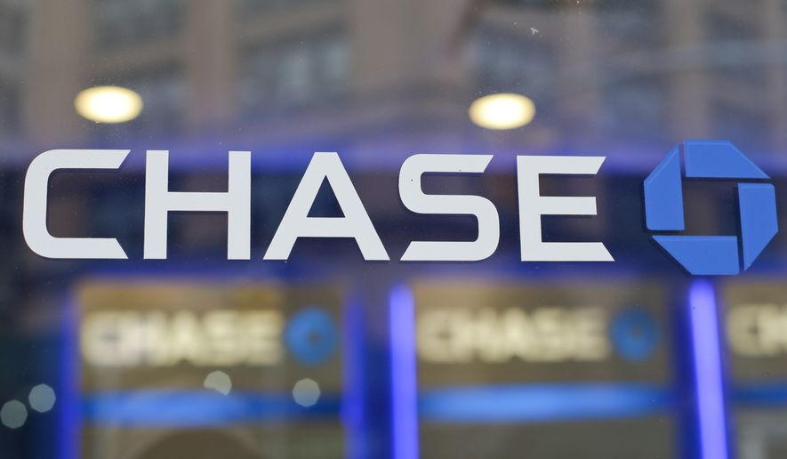 This Sept. 13, 2014, file photo, shows the Chase bank logo in New York. On Thursday, Nov. 17, 2016, JPMorgan Chase & Co., agreed to pay $264.4 million in fines to federal authorities to settle charges that it hired friends and relatives of Chinese officials in order to gain access to banking deals in that country. (AP Photo/Frank Franklin II, File)