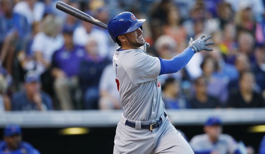 FILE - In this Aug. 20, 2016, file photo, Chicago Cubs' Kris Bryant follows the flight of his three-run home run off Colorado Rockies starting pitcher Jeff Hoffman in the fifth inning of a baseball game, in Denver. Bryant, Daniel Murphy and Corey Seager are up for the National League Most Valuable Player award. (AP Photo/David Zalubowski, File) **FILE**