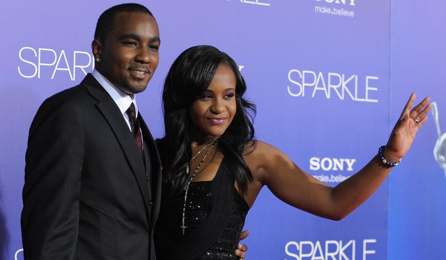 "Nick Gordon and Bobbi Kristina Brown attend the Los Angeles premiere of ""Sparkle"" at Grauman's Chinese Theatre in Los Angeles on Aug. 16, 2012. (Associated Press)"