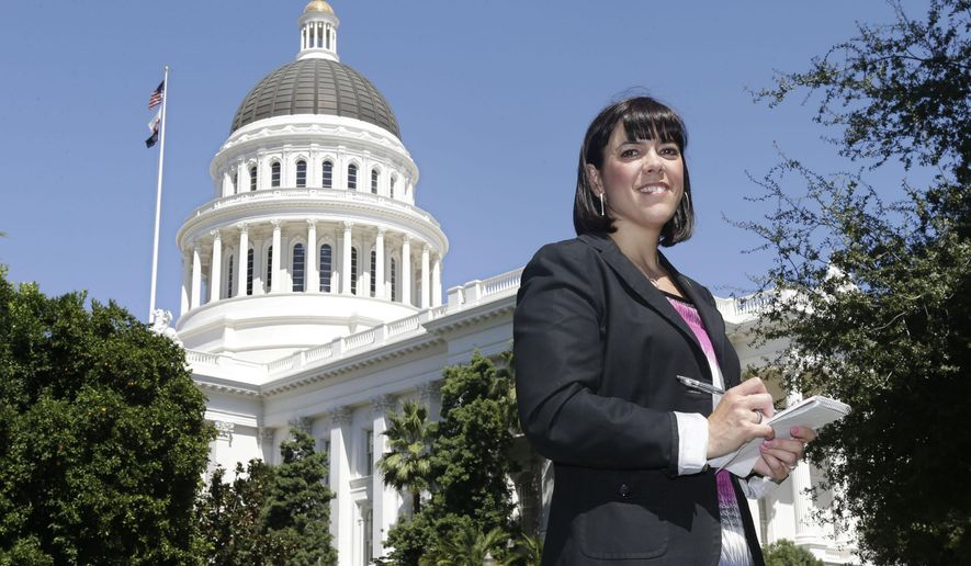 FILE - In this Aug. 21, 2013, file photo, Associated Press journalist Juliet Williams poses outside the state Capitol in Sacramento, Calif. Williams, who as Sacramento correspondent oversaw 2016 California election coverage for The Associated Press, has been named news editor in San Francisco. The appointment was announced Thursday, Nov.. 17, 2016. In her new role Williams will supervise AP staff in San Francisco and Fresno, and be responsible for news coverage throughout Northern California. (AP Photo/Rich Pedroncelli, File)