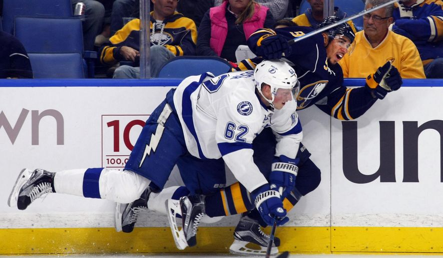 Buffalo Sabres' Evander Kane (9) and Tampa Bay Lightning's Andrej Sustr (62) collide along the boards during the first period of an NHL hockey game, Thursday, Nov. 17, 2016, in Buffalo, N.Y. (AP Photo/Jeffrey T. Barnes)