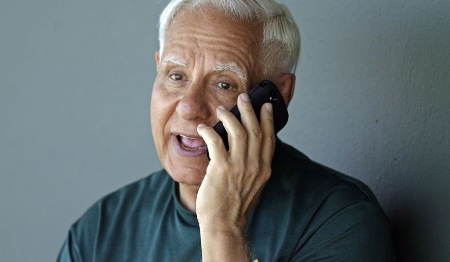 FILE - In this March 27, 2015, file photo, Oakland Athletics owner Lew Wolff speaks on a phone in the dugout prior to a spring training exhibition baseball game against the Texas Rangers in Mesa, Ariz. Wolff is selling all but a small stake in the Oakland Athletics and giving up his managing partner role, turning over leadership of the franchise to John Fisher as the club seeks a new ballpark location. (AP Photo/Ben Margot, file)