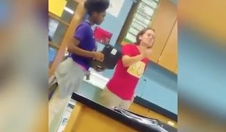 A Baltimore teacher was reportedly fired Thursday after she was captured on video screaming the N-word at students. (Facebook/@Erica Esha Deminds)