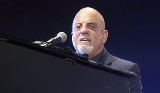 In this July 25, 2015, file photo, singer-songwriter Billy Joel performs in concert at M&T Bank Stadium in Baltimore. (Photo by Owen Sweeney/Invision/AP, File)