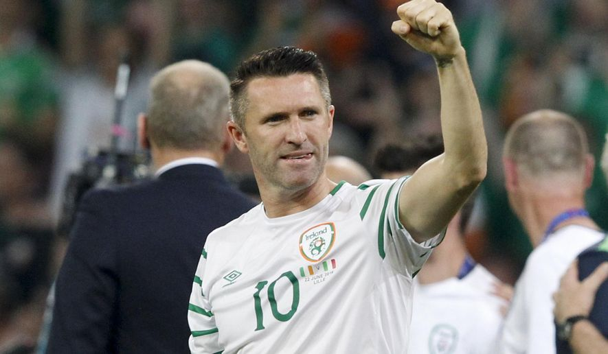 FILE - In this June 22, 2016, file photo, Ireland's Robbie Keane celebrates at the end of the Euro Group E soccer match against Italy in Villeneuve d'Ascq, near Lille, France. Keane is leaving the LA Galaxy after winning three MLS Cup titles in parts of six seasons with the club. The Galaxy and the Irish striker announced their parting Thursday, Nov. 17, 2016. (AP Photo/Antonio Calanni, File)