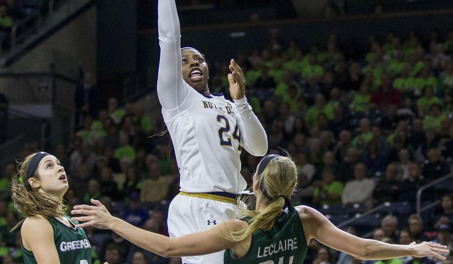 Notre Dame's Arike Ogunbowale (24) goes up for a shot over Green Bay's Laken James (5) and Allie LeClaire (24) during the first half of an NCAA college basketball game Thursday, Nov. 17, 2016, in South Bend, Ind. (AP Photo/Robert Franklin)