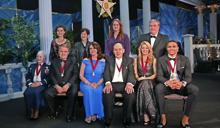 The 2016 inductees into the Oklahoma Hall of Fame pose for a photo along with presenters Thursday, Nov. 17, 2016, in Oklahoma City. From left in front are Rita Bly Aragon, Michael Burrage, Rebecca Dixon, Dan Dillingham, Kelli O'Hara and Russell Westbrook. At rear are four of their presenters, from left, Jane Jayroe Gamble, Molly Shi Boren, Ree Drummond and Pat O'Hara. Presenters Theodore M. Elam and Michael Jordan were not available for the group photo. (AP Photo/Sue Ogrocki)