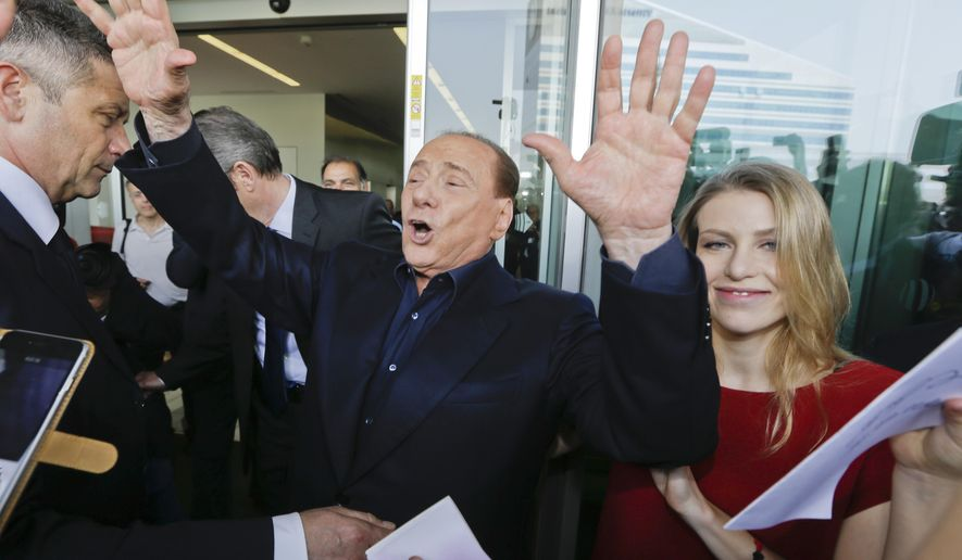 FILE - In this file photo taken on  July 3, 2015, AC Milan president Silvio Berlusconi waves to supporters flanked by his daughter Barbara, outside the Milanese soccer club's headquarters, in Milan, Italy. Next Sunday's it will likely be Silvio Berlusconi's final derby as AC Milan owner. And the first for Inter's new Chinese proprietors. (AP Photo/Luca Bruno)