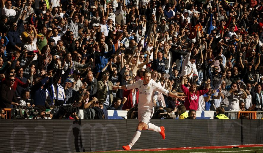 FILE - In this Nov. 6, 2016, file photo, Real Madrid's Gareth Bale celebrates after scoring a goal during a Spanish La Liga soccer match against Leganes in Madrid, Spain. Madrid arrives at the derby in a much better position than previously, holding a two-point lead over Barcelona and a six-point advantage over Diego Simeone's Atletico, which needs the victory to avoid losing more ground to the rivals. (AP Photo/Daniel Ochoa de Olza, File)