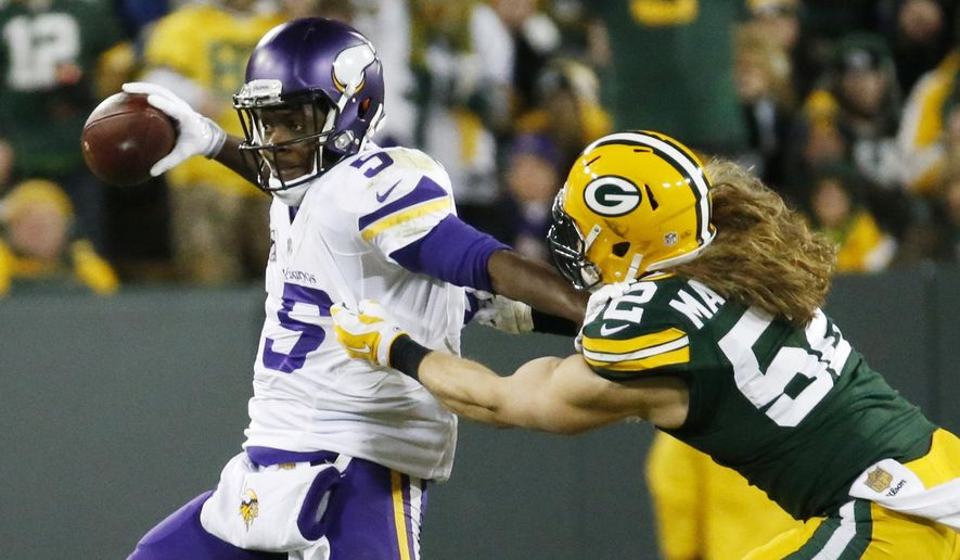 FILE - In this Jan. 3, 2016, file photo, Minnesota Vikings' Teddy Bridgewater tries to get away from Green Bay Packers' Clay Matthews (52) during the first half an NFL football game in Green Bay, Wis. In Matthews and Christine Michael, Green Bay has two players who can only help in areas on opposite sides of the ball in which production has tailed off of late. (AP Photo/Mike Roemer, File)
