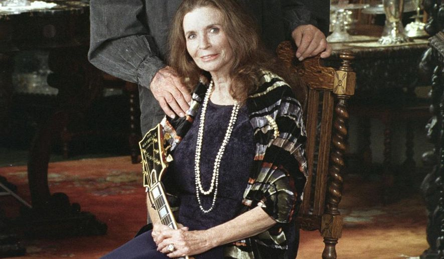 FILE - In this 1999 file photo, late country music legends Johnny Cash and June Carter Cash at their home in Hendersonville, Tenn. The famous Tennessee lakeside property where Johnny and June Carter Cash spent much of their 35-year marriage has been listed for sale. (AP Photo/Mark Humphrey, File)