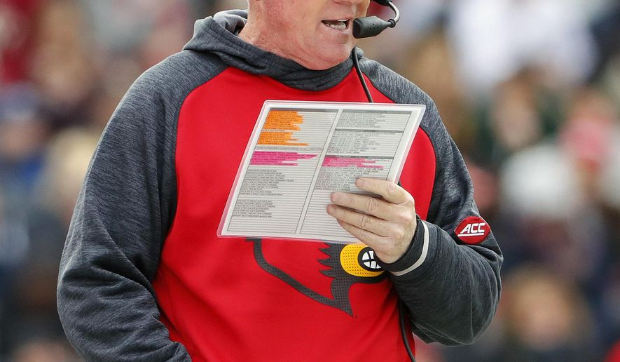 FILE - In this Nov. 5, 2016, file photo, Louisville head coach Bobby Petrino is shown on the sidelines during the first half of an NCAA football game against Boston College at Alumni Stadium in Boston, Mass. The stretch run of the regular season makes it tempting for playoff contenders to run up big margins for the sake of style points, even though members of the College Football Playoff committee insist they don't take margin of victory into consideration when compiling their rankings. (AP Photo/Winslow Townson, File)