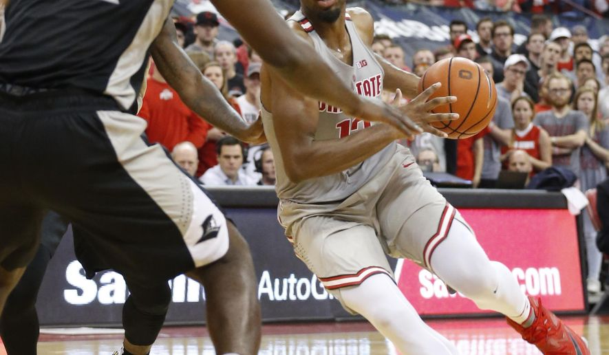 Ohio State's JaQuan Lyle, right, drives to the basket against Providence's Isaiah Jackson during the second half of an NCAA college basketball game Thursday, Nov. 17, 2016, in Columbus, Ohio. (AP Photo/Jay LaPrete)