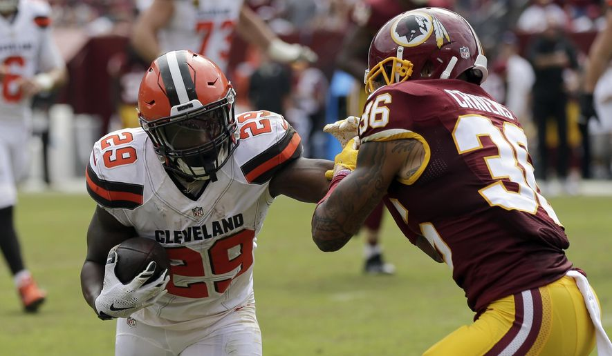 In this file photo taken Oct. 2, 2016, Washington Redskins defensive back Su'a Cravens (36) attempts to tackle Cleveland Browns running back Duke Johnson (29) during the first half of an NFL football game in Landover, Md. (AP Photo/Mark Tenally) ** FILE **
