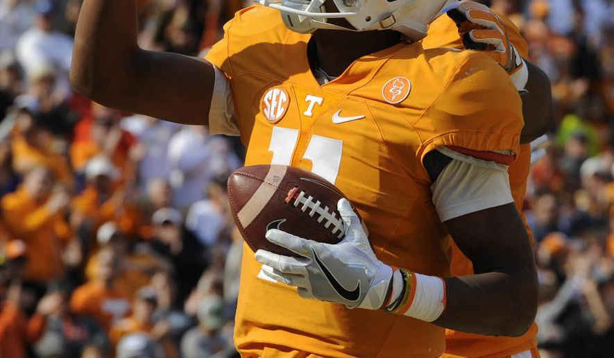 FILE - In this Nov. 12, 2016, file photo, Tennessee quarterback Joshua Dobbs (11) celebrates a one-yard run for a touchdown against Kentucky during the first half of an NCAA college football game at Neyland Stadium in Knoxville, Tenn. After beginning their college careers by experiencing losing seasons and helping rebuild the program, Tennessee's seniors prepare for their final home game stiill hoping for one last shot to play for a Southeastern Conference title. (Saul Young/Knoxville News Sentinel via AP, File)