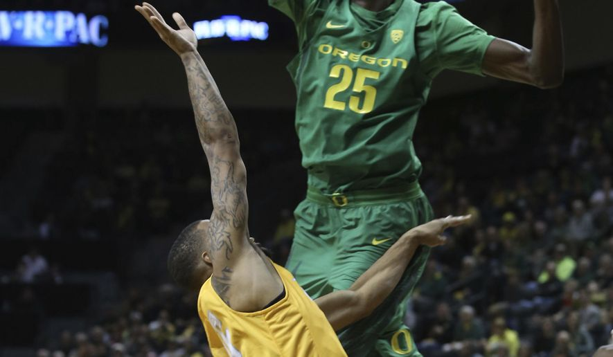 Oregon's Chris Boucher, right, blocks a shot by Valparaiso's Lexus Williams during the second half of an NCAA college basketball game Thursday, Nov. 17, 2016, in Eugene, Ore. (AP Photo/Chris Pietsch)