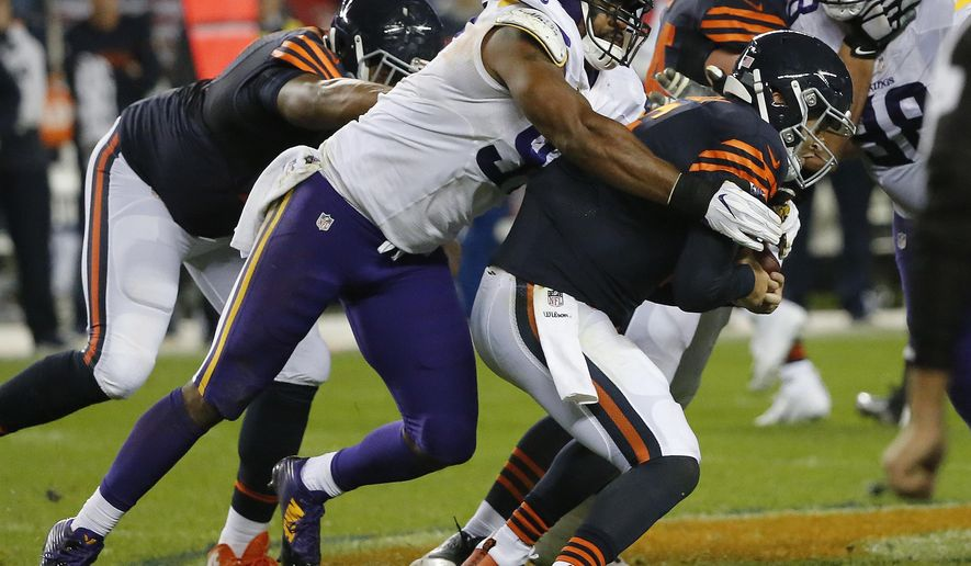 FILE - In this Oct. 31, 2016, file photo, Minnesota Vikings defensive end Everson Griffen (97) sacks Chicago Bears quarterback Jay Cutler (6) during the second half of an NFL football game, in Chicago. Overshadowed by the injuries and ineffectiveness on Minnesota's offense has been a recent return to ordinary by a Vikings defense that was dominant over the first five games. They still lead the NFL with the fewest points allowed, despite the recent rut. (AP Photo/Charles Rex Arbogast, File)