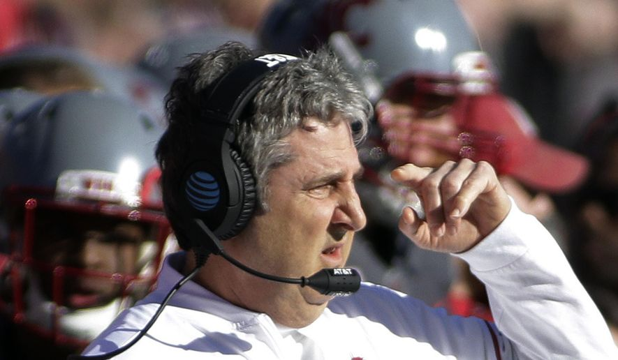 FILE - In this Nov, 5, 2016, file photo, Washington State head coach Mike Leach directs his team during the first half of an NCAA college football game against Arizona in Pullman, Wash. Leach has been one of the best program-builders in coaching over the past two decades. (AP Photo/Young Kwak, File)