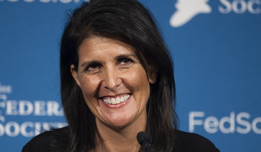 South Carolina Gov. Nikki Haley smiles while speaking at the Federalist Society's National Lawyers Convention in Washington, Friday, Nov. 18, 2016. (AP Photo/Cliff Owen)