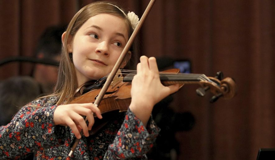 In this Nov. 17, 2016 picture Alma Deutscher plays violin during a rehearsal in Vienna, Austria. Alma Deutscher is a composer, virtuoso pianist and concert violinist who wrote her first sonata five years ago and whose first full opera will have its world premiere next month. All of which is special only because she 11. (AP Photo/Ronald Zak)