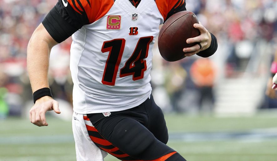 FILE - In this Oct. 16, 2016, file photo, Cincinnati Bengals quarterback Andy Dalton runs for a touchdown during an NFL football game against the New England Patriots, at Gillette Stadium in Foxborough, Mass. The Buffalo Bills host the Bengals on Sunday. (AP Photo/Winslow Townson, File)