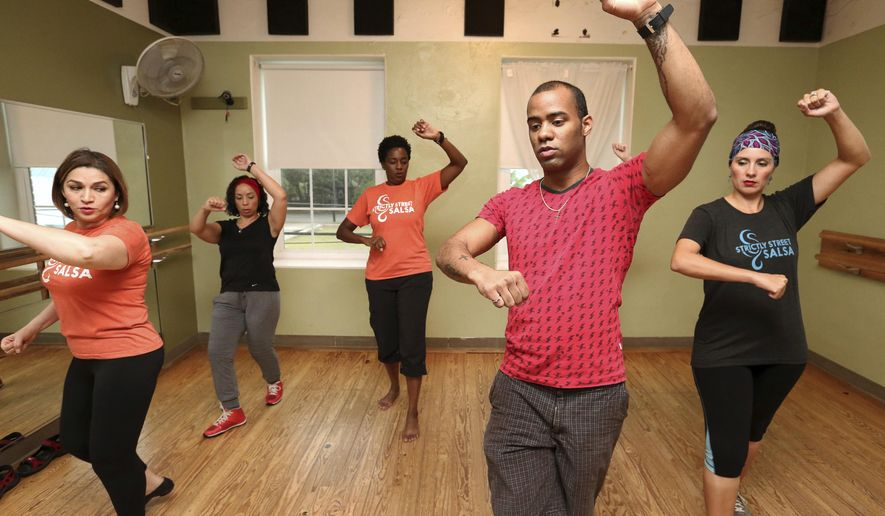 ADVANCE FOR SUNDAY, NOV. 20 AND THEREAFTER - In a Sunday, Nov. 6, 2016 photo, Afro-Latino dancers of Strictly Street Salsa learn a new Orisha Shango style dance from instructor Rey Salsa, in Houston. According to a 2015 Pew survey, about a quarter of U.S. Hispanics identify themselves as Afro-Latino. Afro-Latinos are generally descendants of African slaves brought to Spanish and Portuguese colonies in Latin America and the Caribbean.  (Yi-Chin Lee/Houston Chronicle via AP)