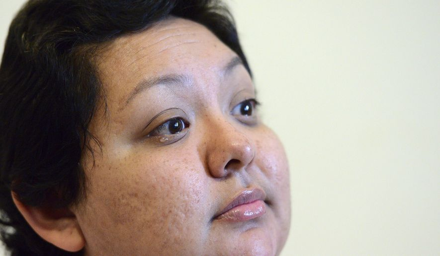 ADVANCE FOR USE SUNDAY, NOV. 20, 2016 AND THEREAFTER - In this Oct. 28,  2016 photo, Elida Cano tears up she talks about getting her diagnosis of stage 4 breast and ovarian cancer during an interview in Elgin, Ill. Only 32, she is pushing for awareness and for women, Latinas especially, to get annual mammograms.(Rick West/Daily Herald, via AP)