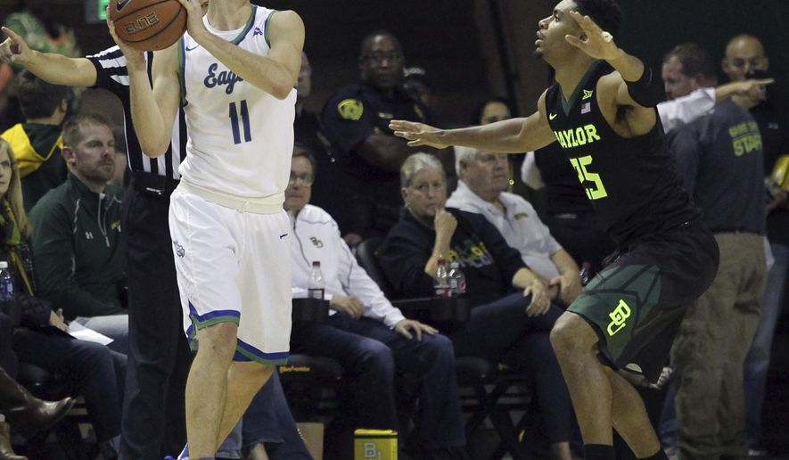 Florida Gulf Coast's Christian Terrell (11) is guarded by Baylor's Al Freeman (25) during the first half of an NCAA college basketball game, Friday, Nov. 18, 2016, in Waco, Texas. (Jerry Larson/Waco Tribune Herald via AP)