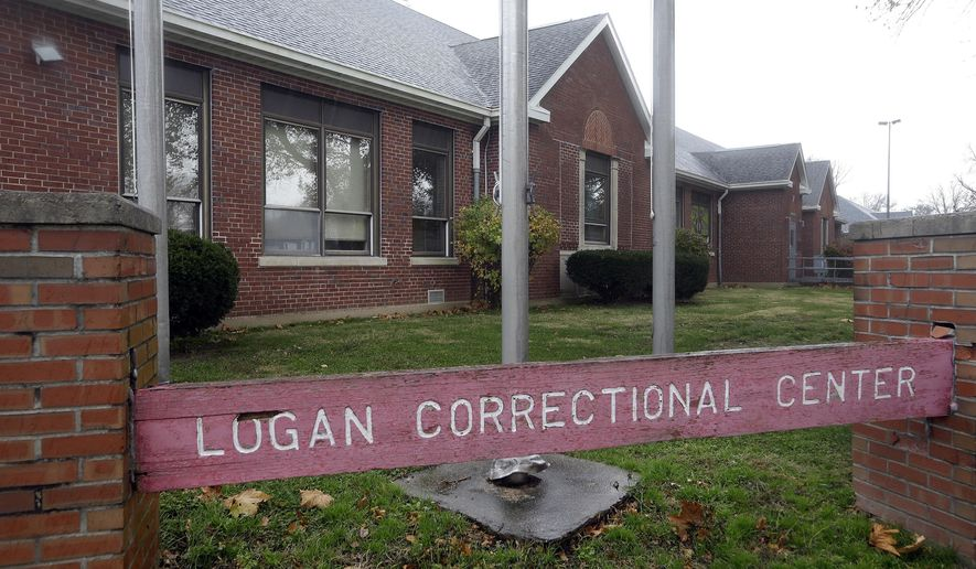 "Rain falls on the Logan Correctional Center administration building Friday, Nov. 18, 2016, in Lincoln, Ill. Inmates at Illinois' major women's prison have been called ""crazy"" and ""worthless"" by corrections officers, are sometimes placed in an unpadded open-bar ""crisis cage"" and receive harsher discipline than men for similar offenses, a study released Friday says. (AP Photo/Seth Perlman)"