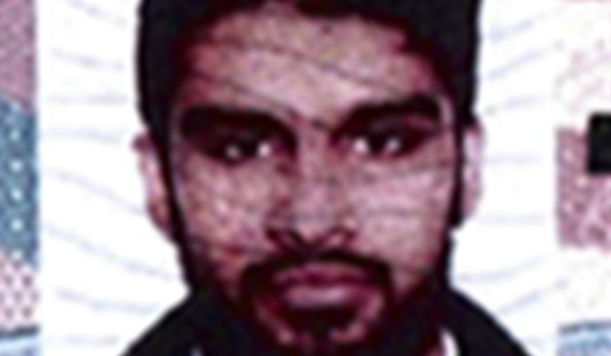 FILE - This undated passport photo provided by the U.S. Attorney's Office in Chicago shows Mohammed Hamzah Khan. Khan faces a maximum 15-year sentence for seeking to provide material support to terrorists when he is sentenced Friday, Nov. 18, 2016, in Chicago. He was arrested attempting to board at a Chicago airport bound for Syria.  (U.S. Attorney's Office via AP, File)