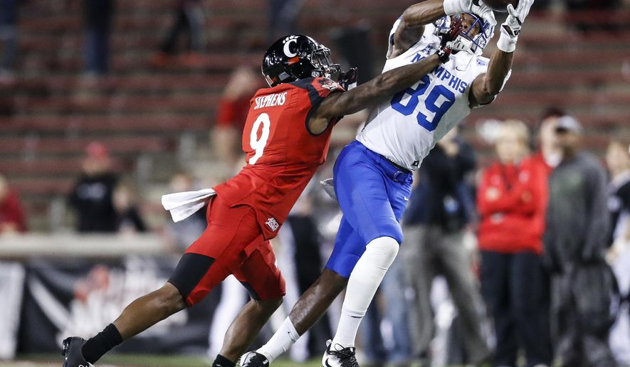 Memphis wide receiver Phil Mayhue (89) catches a pass against Cincinnati cornerback Linden Stephens (9) in the second half of an NCAA college football game, Friday, Nov. 18, 2016, in Cincinnati. Memphis won 34-7. (AP Photo/John Minchillo)