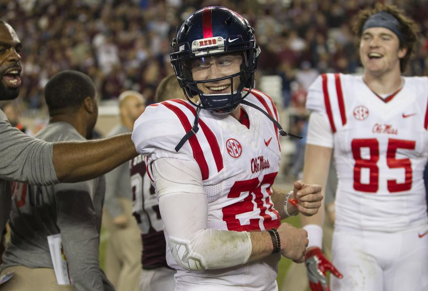 FILE - In this Nov. 12, 2016, file photo, Mississippi quarterback Shea Patterson (20) celebrates with teammates after a 29-28 win over Texas A&M in an NCAA college football game, in College Station, Texas. Vanderbilt is hosting Ole Miss on Saturday night with time and games running out to become bowl eligible. (AP Photo/Sam Craft)