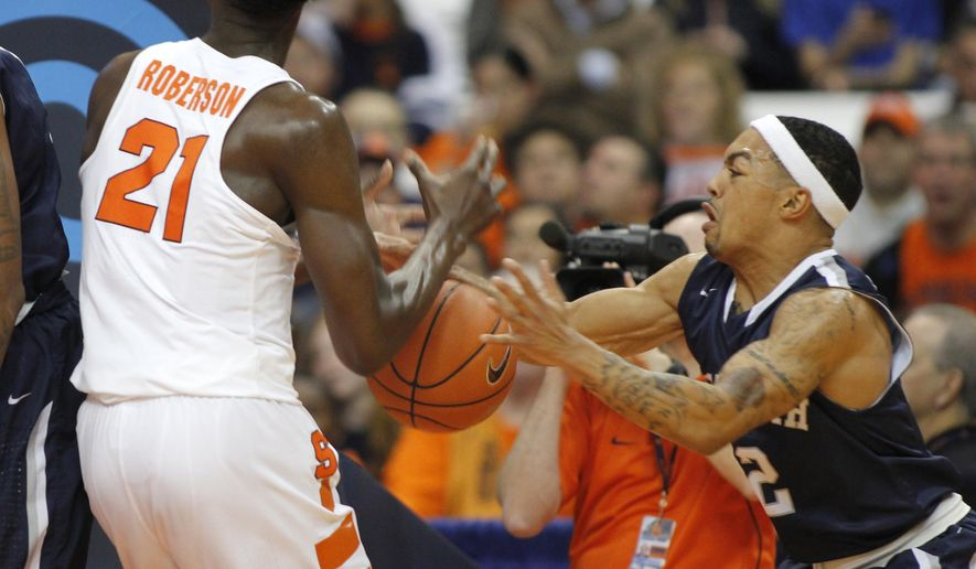 Monmouth's Justin Robinson, right, grabs the ball from Syracuse's Tyler Roberson, left, in the first half of an NCAA college basketball game in Syracuse, N.Y., Friday, Nov. 18, 2016. (AP Photo/Nick Lisi)