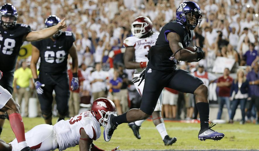 FILE - In this Sept. 10, 2016, file photo, Arkansas linebacker Dre Greenlaw (23) is unable to stop TCU running back Kyle Hicks on a touchdown during an NCAA college football game in Fort Worth, Texas.  Hicks and Oklahoma State freshman Justice Hill both have 789 yards rushing this season. But Hicks is third in the Big 12 with 87.7 yards per game, ahead of Hill at 78.9 yards per game. (AP Photo/Tony Gutierrez, File)