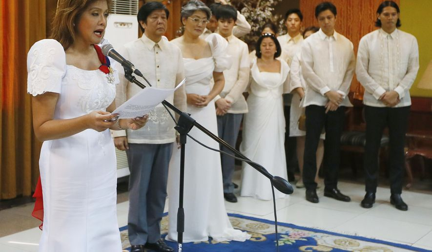 Gov. Imee Marcos reads her family's statement after the late Ferdinand Marcos, her father, was buried at the Heroes' Cemetery Friday, Nov. 18, 2016, in Pasay, Philippines. Ferdinand Marcos was buried at a heroes' cemetery Friday in a secrecy-shrouded ceremony, police officials said, despite growing opposition after the Supreme Court ruled that one of Asia's most infamous tyrants can be entombed in the hallowed grounds. (AP Photo/Bullit Marquez)