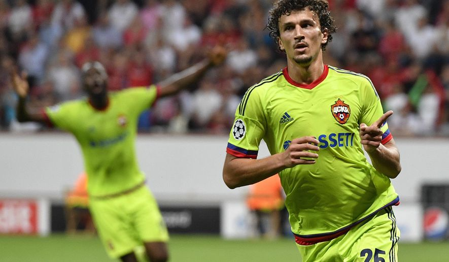 FILE In this Wednesday, Sept. 14, 2016 file photo CSKA's Roman Eremenko celebrates after scoring his side's second goal during the Champions League Group E soccer match between Bayer Leverkusen and CSKA Moscow in Leverkusen, Germany. UEFA has banned Finland midfielder Roman Eremenko for two years after he tested positive for cocaine, it was reported on Friday, Nov. 18, 2016. (AP Photo/Martin Meissner, File)