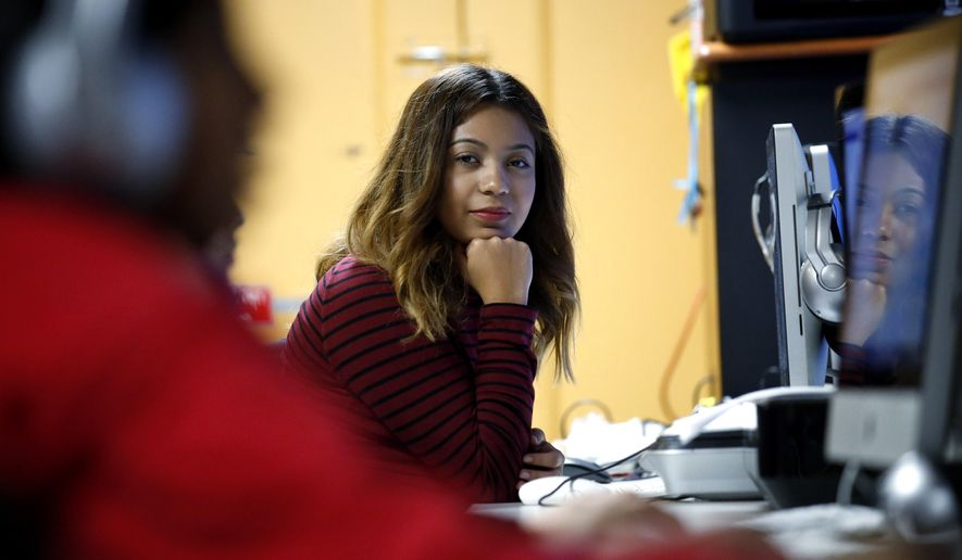 Andrea Aguilera sits at the Erie Neighborhood House in Chicago, Thursday, Nov. 17, 2016. Aguilera, 20, a student at a suburban Chicago college, said she feels uncertain since the election. She was brought to the country illegally as a child and has been able to get a work permit and avoid deportation through a federal program called, Deferred Action for Childhood Arrivals. She said she doesn't know what will happen next with the program. (AP Photo/Nam Y. Huh)