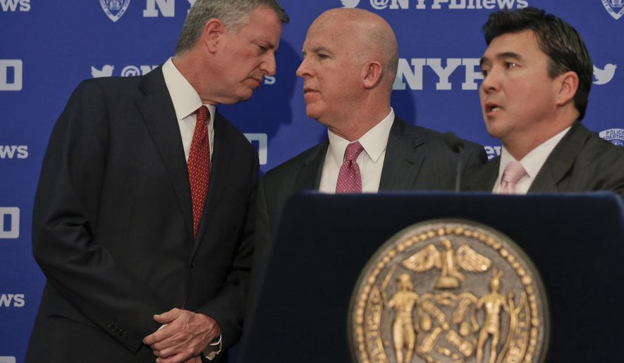 Mayor Bill de Blasio, left, and NYPD Commissioner James O'Neill, center, confer while U.S. Secret Service Special Agent David Beach, right, speaks during a press conference discussing plans for new security and traffic restrictions around Donald Trump's headquarters at Trump Tower, Friday Nov. 18, 2016, in New York. (AP Photo/Bebeto Matthews)